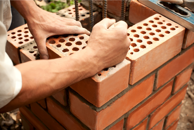 Brick Laying by a worker